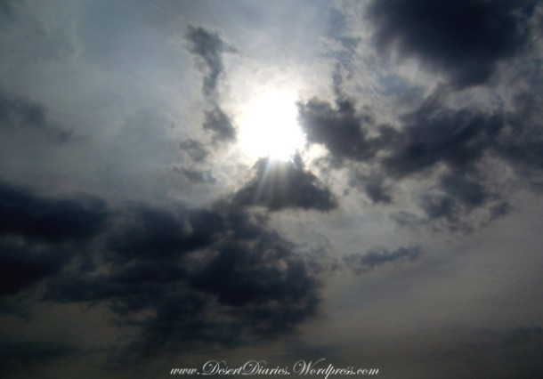 A beautiful shot of the sun amongst some clouds after a light rain shower back in '06.